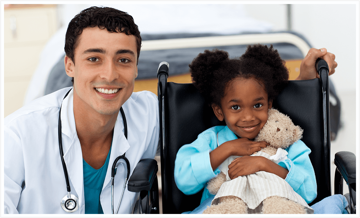 Doctor with child in wheelchair
